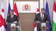 Hungarian Prime Minister Victor Orban is welcomed by his Georgian counterpart Giorgi Kvirikashvili during the official welcoming ceremony in Tbilisi...