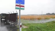 Hungary has announced that is has started to roll out barbed wire along its border with Slovenia after having set up similar barriers along its...