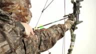 Hunter drawing bow back
