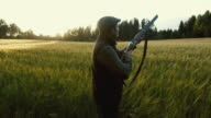 Hunter shoots a weapon at golden hour