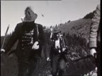 1937 B/W MONTAGE Hunters coming back from hunt in mountains, carry deer / Tyrol, Austria