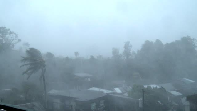 Hurricane force winds rip through Legaspi city as powerful typhoon Ramassun makes landfall on 15th July 2014