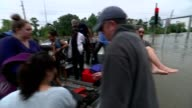 thousands forced to evacuate as more rain expected Houston Various of evacuees helped from volunteer rescue boats / Edwin Muir interview SOT/...