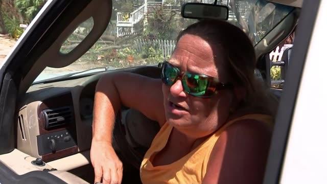 Florida Keys Florida Keys Islamorada EXT Amy Denius interview SOT/ Florida Keys SHOT form car as along past destroyed and damaged houses POINT OF...