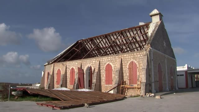 Anger at UK hurricane response ANGUILLA INT Church aisles TILT UP missing roof Church building with roof on ground alongside Seats at Ferry terminal...