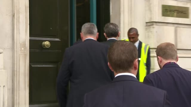 UK government response ENGLAND London Whitehall EXT Michael Fallon MP along and inton Cabinet Office arriving for emergency Cobra meeting about...