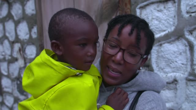 Mother and son reunited DOMINICA EXT Young girl Nyia speaking to camera as standing in ladscape of destroyed houses and roads [aftermath of Hurricane...