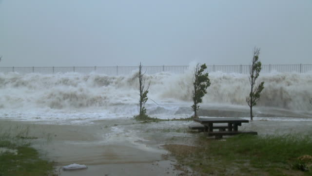 Hurricane Storm Surge Waves Crash Over Sea Wall