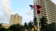 Hurricane warning flags fly in strong wind in downtown Miami ahead of hurricane Irma's landfall