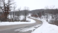 WS Husband and wife ridding on motorcycle with sidecar in rural area during winter / Osceola, Wisconsin, United States