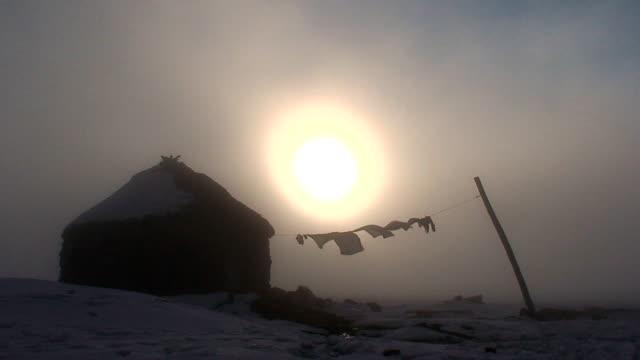Hut and sun in harmony