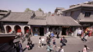 Hutong, alley, shops, rooftops, pedestrians, Beijing, China