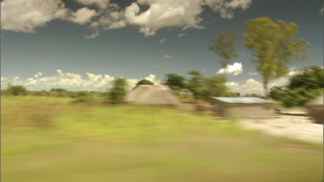 Huts cover the countryside in Zambia.