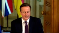 Prime Minister agrees to Inquiry ENGLAND London Downing Street David Cameron MP and Angela Merkel sitting together at press briefing David Cameron MP...