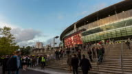 LONDON - CIRCA 2013: Hyper Lapse, hyperlapse, time lapse of Arsenal Emirates Stadium during sunset with crowd before a football match