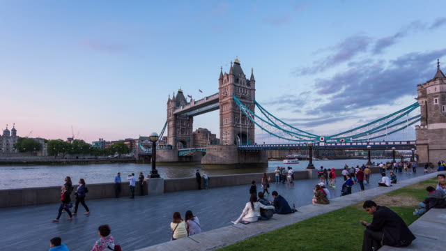 LONDON - CIRCA 2013: Hyper Lapse, hyperlapse, time lapse of Tower Bridge during sunset with people walking