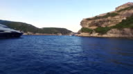 Hyper lapse of boat entering the Bonifacio harbor by the old fort in Corsica, France