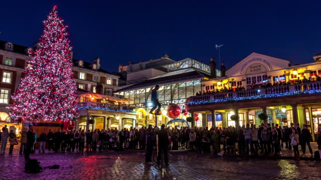 LONDON - CIRCA 2012: Hyper Lapse - Time lapse of people walking through streets decorated for Christmas in Covent Garden circa 2012 in London, UK.