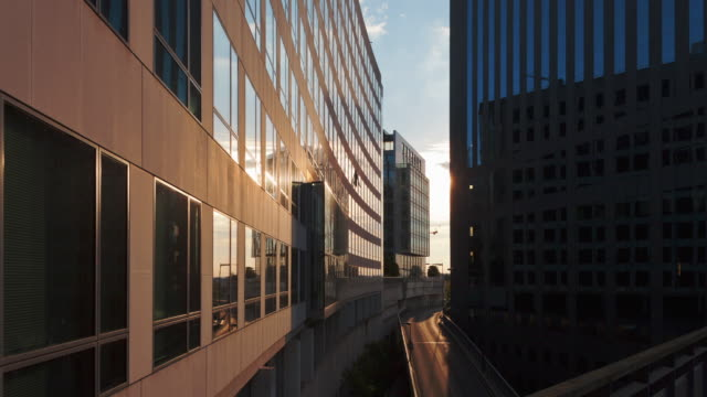 Hyperlapse Time lapse tracking shot at sunset in business district La Defense Paris