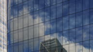 Hyperlapse Time lapse tracking shot with glass reflections and clouds on office buildings