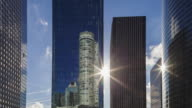 Hyperlapse Time lapse tracking shot with sun and reflection in office and business district La Defense Paris
