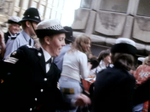 Hysterical Bay City Rollers fans rush police as they get a glimpse of their favourite band 1975