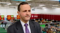 Iain Duncan Smith and Steve Webb visit ASDA supermarket in Clapham ENGLAND London Clapham Junction INT High angle view of Steve Webb MP in ASDA store...