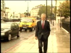 Iain Duncan Smith forced to resign as leader of Conservative Party ITN Michael Howard MP across street in to car David Davis MP along street towards...