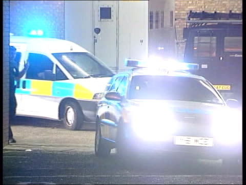 Ian Huntley charged with murder held in secure unit GV Court with police on duty outside MS Windows of building as police seen inside MS Police vans...
