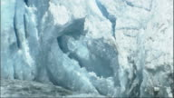 Ice breaks off the Columbia Glacier and splashes into Prince William Sound in Alaska. Available in HD.