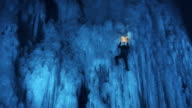 Ice climber ascending the slope in wonderful night light