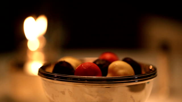 Ice cream Truffle with Restaurant candle flame background