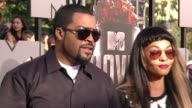 Ice Cube and Kimberly Woodruff at the 2014 MTV Movie Awards at Nokia Theatre LA Live on April 13 2014 in Los Angeles California