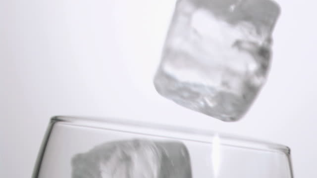 Ice cube falling in super slow motion