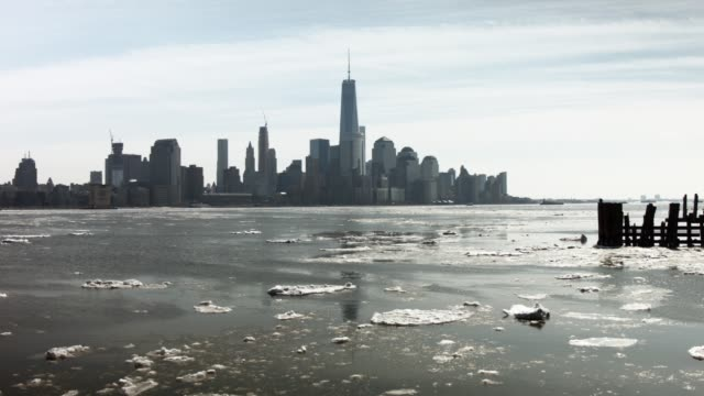 Ice floats in the Hudson River with lower Manhattan in the background on February 25 2015 in Hoboken New Jersey New York City and much of the East...