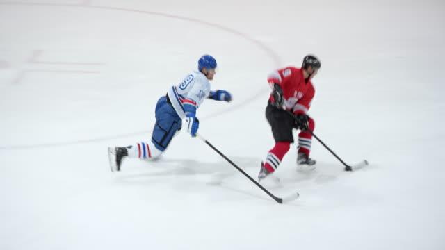 Ice hockey goalie makes a save
