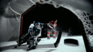 SLO MO Ice hockey player scoring a goal
