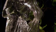 TILT UP CU Ice sculpture of wedding couple