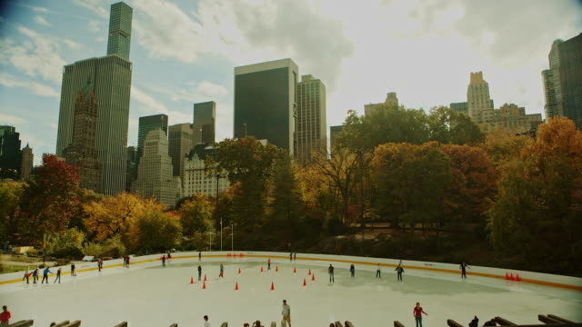 Ice skating at Autumn in Central Park New York City