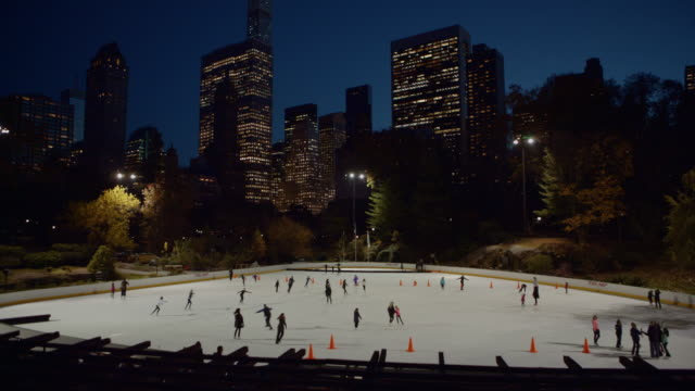 Ice skating in Central Park at dusk New York City