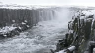 Iceland Selfoss Waterfall in winter with snow