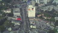 Iconic images cover the sides of high-rises along Sunset Boulevard.