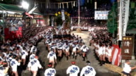 ideo footage taken on July 15 shows teams of scantily clad participants bearing large ornately decorated floats as they race through Fukuoka at the...