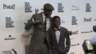 Idris Elba and Abraham Attah at 2016 Film Independent Spirit Awards Press Room on February 27 2016 in Santa Monica California