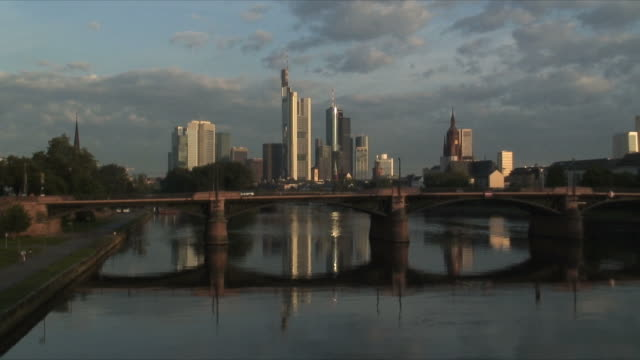 WS Ignatz Bubis Bridge on river Rhine with downtown skyline in background, Frankfurt am Main, Germany