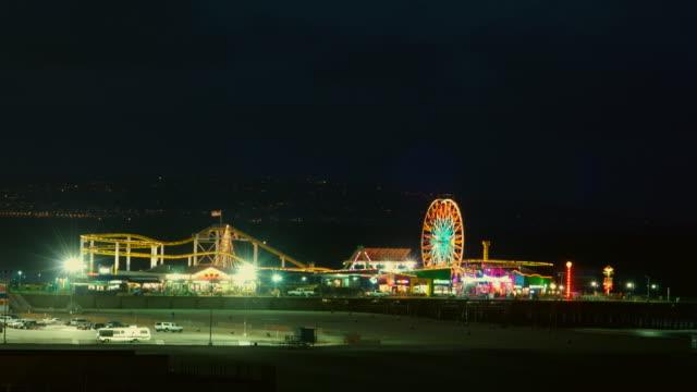 T/L, WS, Illuminated amusement park at Santa Monica Pier, day to night, California, USA