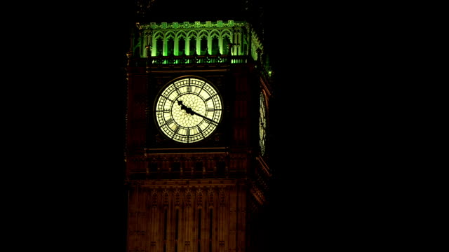 MS ZI Illuminated Big Ben against sky at night / Westminster, London, England