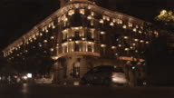 WS LA Illuminated hotel with traffic passing by / Rome, Italy