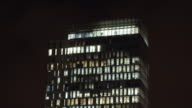 Illuminated office building at night at Amsterdam Zuidas business district