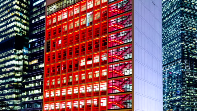 Illuminated office building facade in hong kong at night,time lapse.